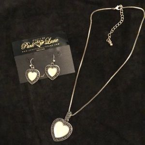Antique silver finished necklace and earrings.